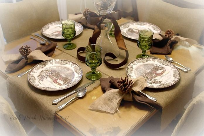A rustic Christmas table set with Friendly Village and Burlap accented with Green and Brown