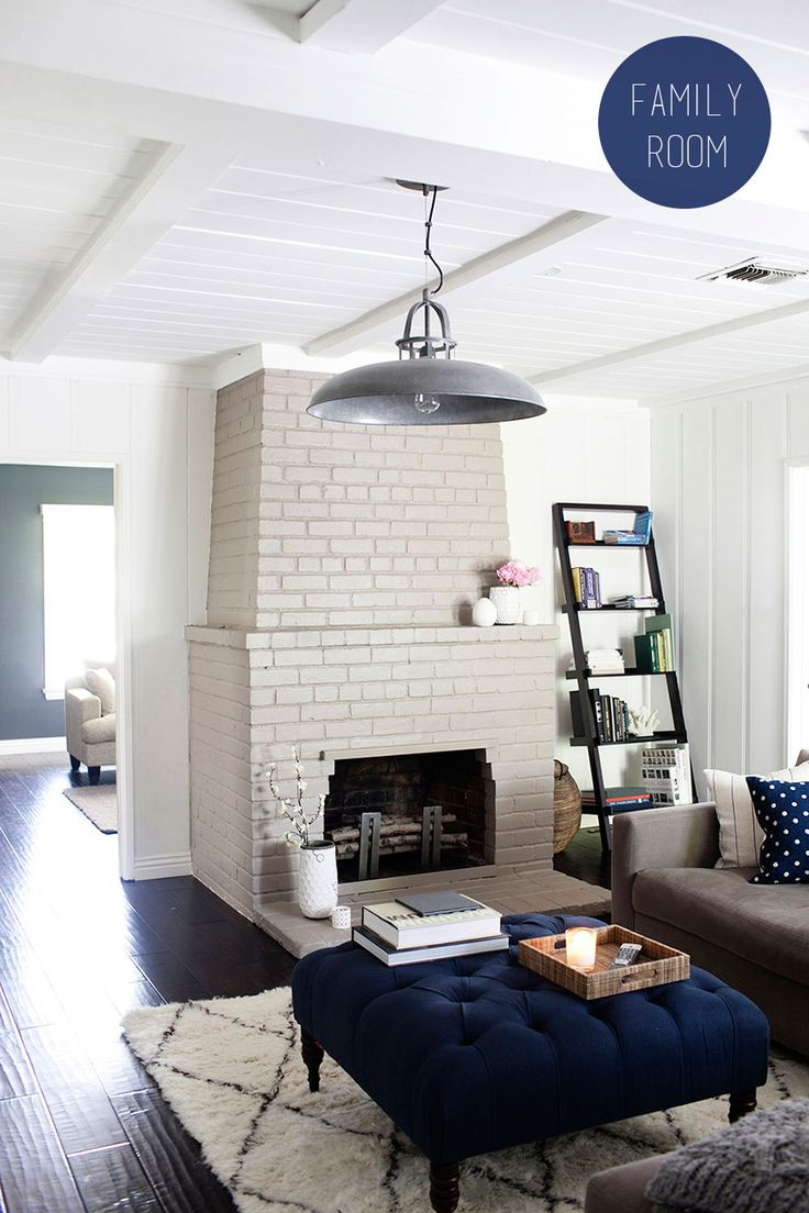 Gray And Navy Living Room With Painted Brick Fireplace By The Effortless Chic Photography Kimberly Genevieve