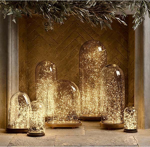 Another alternative to decorating a non-working fireplace. Try using fairy lights that are not only on a timer, but also with a remote control and place them into a clear glass container.