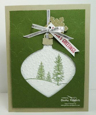 Cardstock: Crumb Cake, Mossy Meadow, Whisper White Stamp Set:  Happy Scenes, Flurry of Wishes Accessories:  Softly Falling Embossing Folder, Modern Mosaic Embossing Folder, Big Shot, Snow Flurry Punch, Delicate Ornament Thinlits, Silver Ribbon
