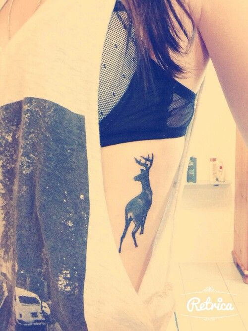 Deer tattoo… LOVE this. simple and i love the placement but I would want it to be just a little more detailed