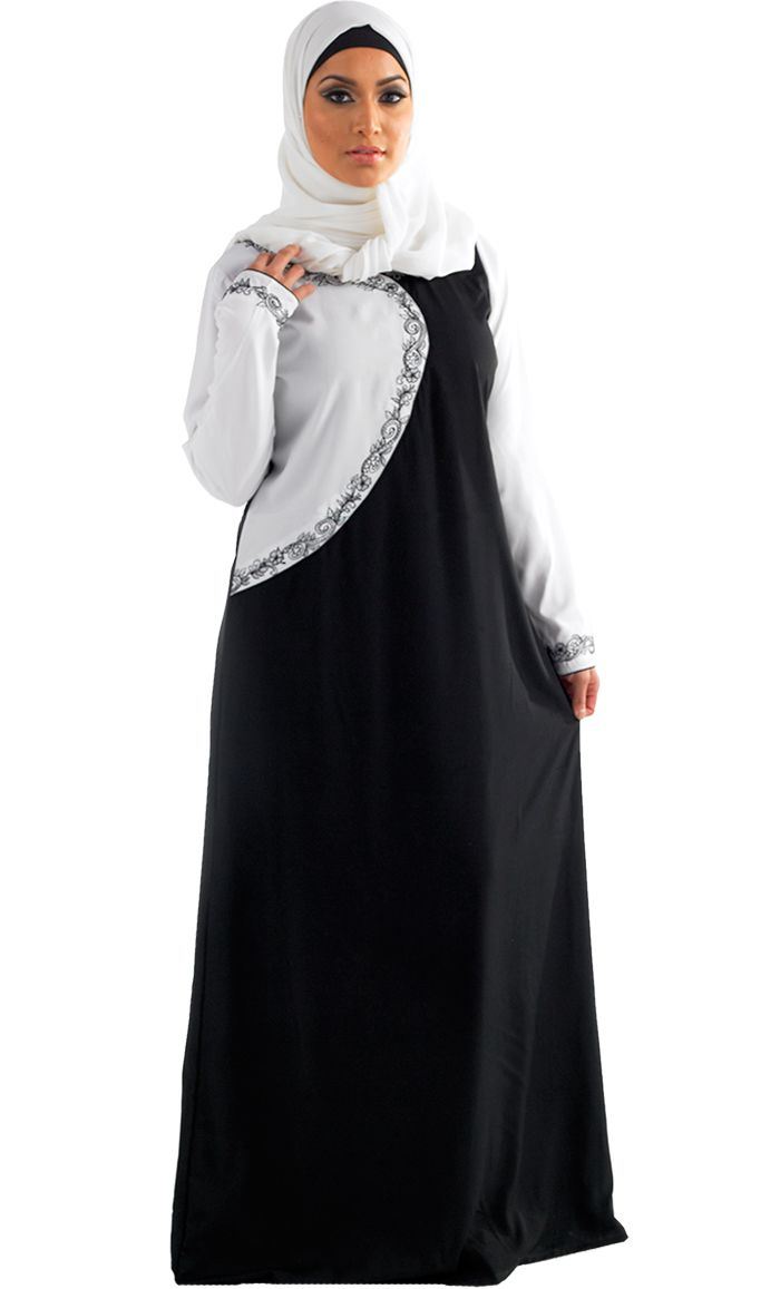 This abaya combines modern and modesty! Round Neck line, A line skirt and decorative embroidery around the neck , chest and cuffs. The black and white mix gives it a touch of class. Slim piping of black on white and white on black to give it a touch of elegance. Fabric: Poly Crepe