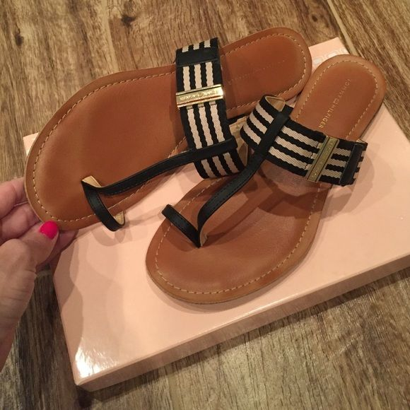 Tommy Hilfiger slip on sandals Cute! These are more like dressy flip flops? Loop for big toe. Cute design. Comfortable. Size 7.5. I'm typically a size 8, so they can fit an 8 also. Open to offers!! Tommy Hilfiger Shoes Sandals