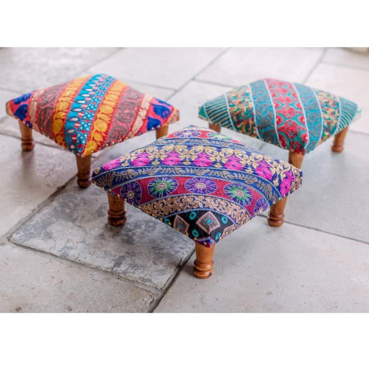 embroidered footstool in vibrantly patterend cotton soft upholstered seat on wooden legs perfect chair