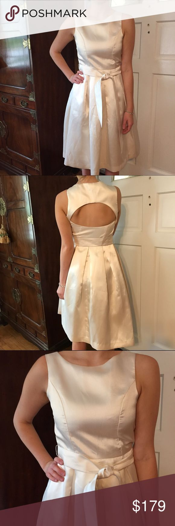 🎄Isaac Mizrahi Cream Cocktail Dress. Size 0 Isaac Mizrahi New York Cream Cocktail Dress with cutout back. Size 2. Bust area is on the smaller side. Bust: 14 inches measured flat across front. Waist: 13 inches measured flat across the front. A-line skirt is 42 inches long. Self tie. Side inside zipper with hook at the top.  Polyester taffeta type material. Perfect for your holiday party.   Very elegant. Isaac Mizrahi Dresses Midi