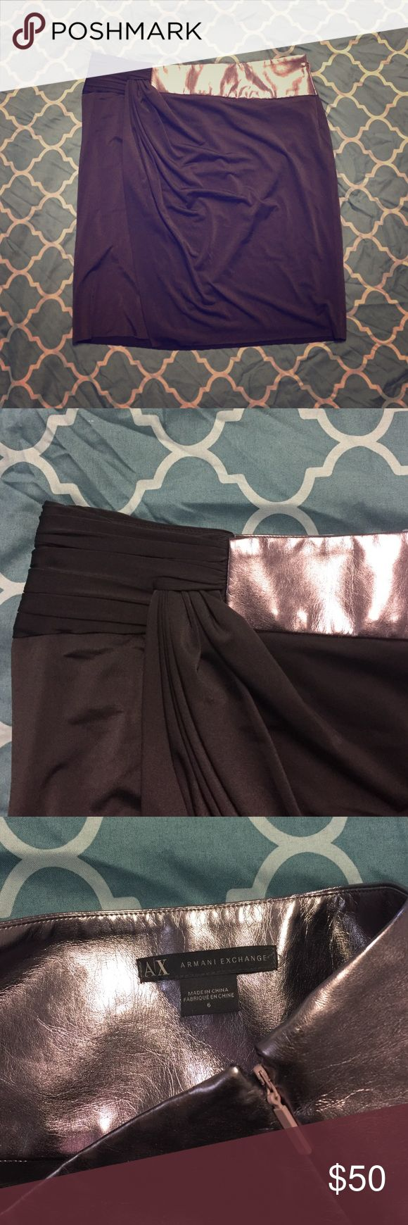 Armani exchange mini skirt Never worn skirt with side zipper. Very soft  black fabric with pewter on the left side. Slit on the right. 19 inches. Armani Exchange Skirts Mini