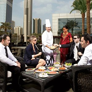 Ali Hussain,chef,people,dining area,outdoor dining,meze,small dishes,Lebanese meze,Al Nafoorah,restaurant,Jumeirah Emirates Towers,Emirates Tower Two,hotel,luxury hotel,businessman,businesswoman,hookah,rooftop,terrace,cityscape,skyline,city view,food plate,Persian Gulf