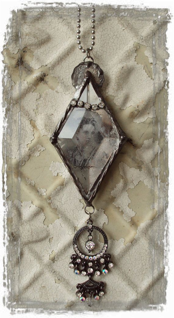 Antique soldered necklace against wall of cracked paint. By Mosshillstudio.