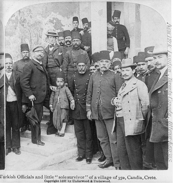 "Turkish officials and little ""sole survivor"" of a village of 350, Candia, Crete 1897"