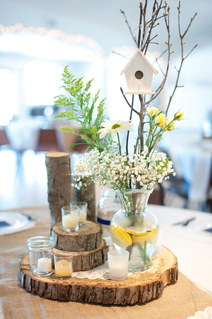 tree trunk slices, simple flowers, bird house...  Tree slices available here http://www.theweddingofmydreams.co.uk/products/tree-slice-rustic-wedding-centrepiece