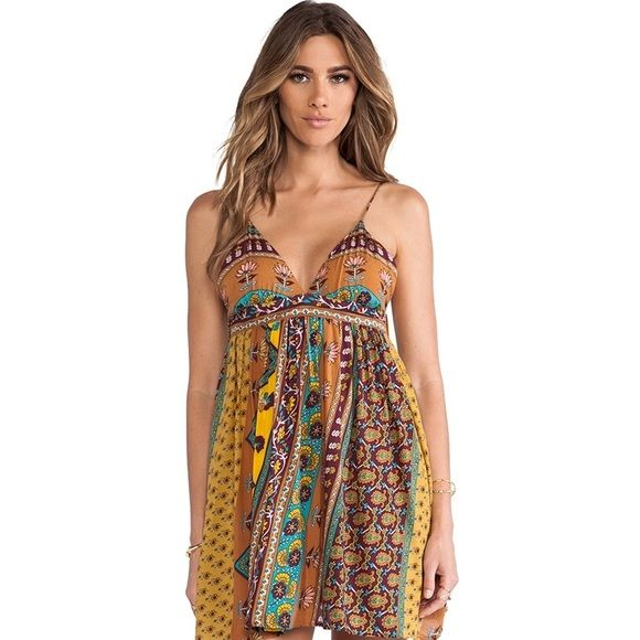 Novella Royale Miss Mae Dress NWT Brand new with tags attached Novella Royale Miss Mae dress in mustard ethnic floral pattern. Gorgeous boho piece recently discontinued by Novella. Size small. Novella Royale Dresses
