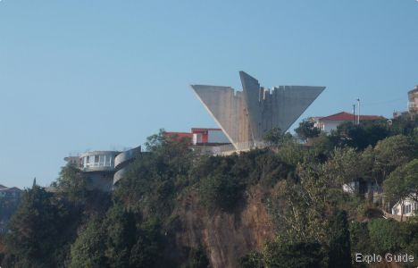 War Memorial in Ulcinj | Atlas Obscura - The Ulcinj War Memorial sits on the edge of the mountain-top town and pays homage to Montenegro's war times, specifically the Yugoslavian air force. Its unique structure resembles wings of a bird, or possibly an airplane, and seems to be keeping watch over the Mala Plaza (meaning Small Beach) below.