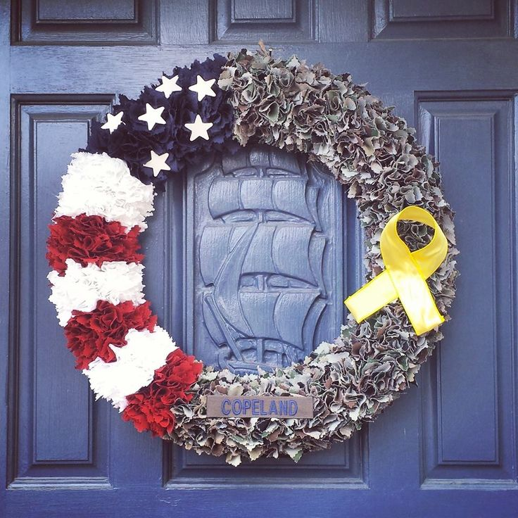 "18"" Flag/BDU combination wreath with Name tape and Yellow support ribbon Total $55 https://www.facebook.com/media/set/?set=a.634024570059302.1073741840.553114074817019&type=3"