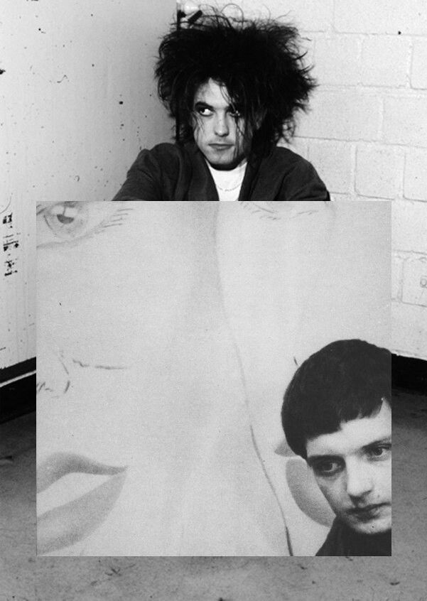 Robert Smith holding a poster of Ian Curtis