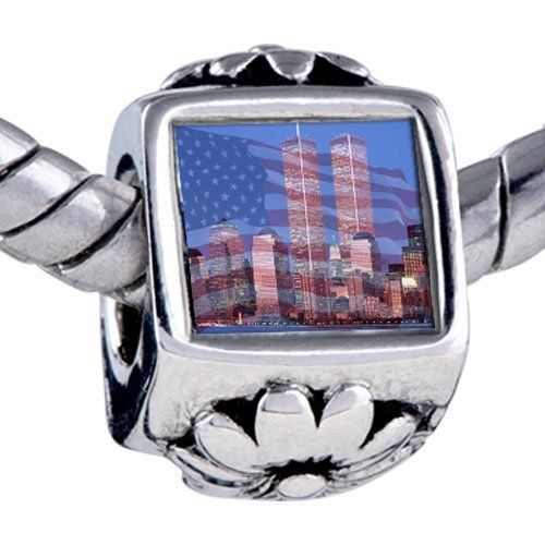 Pugster American Twin Towers Beads - Oriana Bead & Bracelet Compatible Pugster. $12.49. Fit Pandora, Biagi, and Chamilia Charm Bead Bracelets. Unthreaded European story bracelet design. Bracelet sold separately. It's the photo on the flower charm. Hole size is approximately 4.8 to 5mm