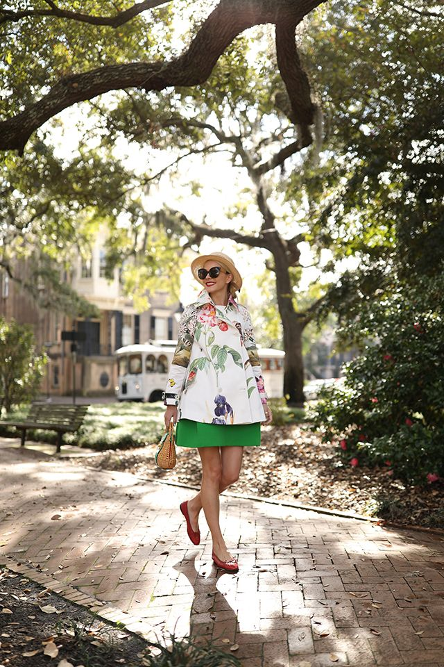 Blair Eadie of Atlantic-Pacific in Savannah wearing a Stella McCartney floral trench, Chanel flats, Mark Cross basket bag and Delpozo skirt.