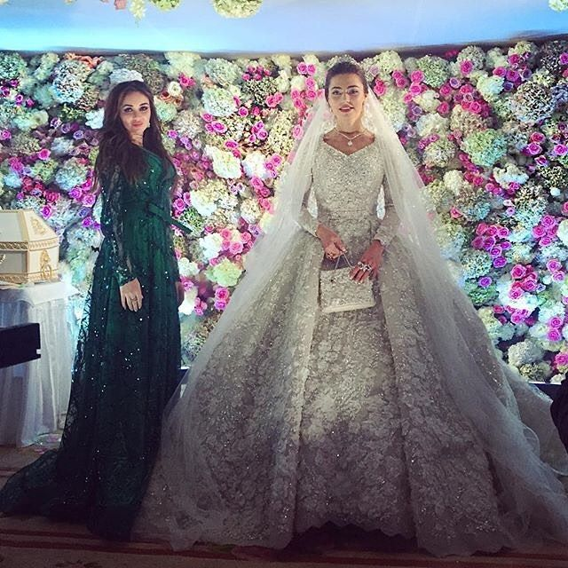 "Pin for Later: Billionaires, Royals, and Even Blair Waldorf All Turned to This Fashion House For Their Big Day Russian Bride Khadija Uzhakhovs's Elie Gown Made Headlines When She Said ""I Do"" The voluminous dress sparkled and shined on her big day."