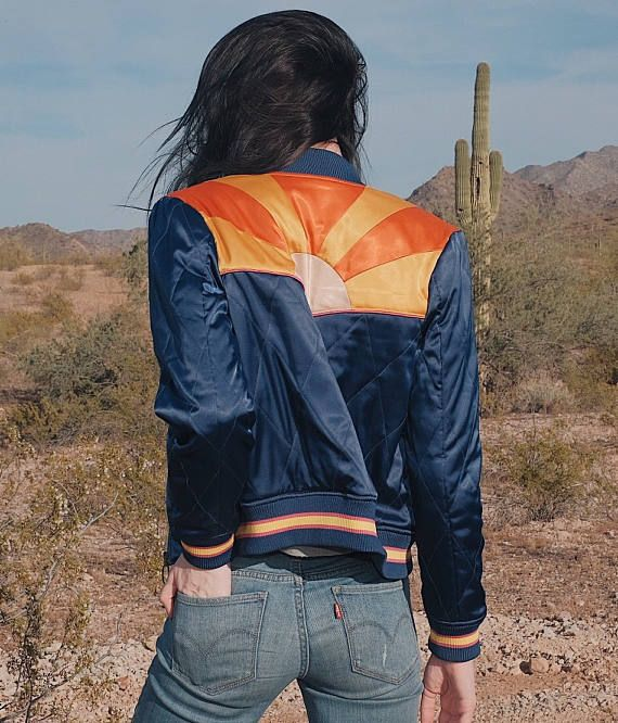 Inspired by the Arizona desert sunset and 70s ski bunny attire, this satin quilted bomber jacket is one of our biggest -- and first! -- feats yet in fashion design. In our years of hunting vintage, we have undyingly dreamed of finding a jacket like this on a thrift store rack or at an estate sale, with no avail. So we took matters into our own hands by crafting this gem from scratch, with all the most desirable qualities -- from the lightweight quilted texture all the way down to the 60s…