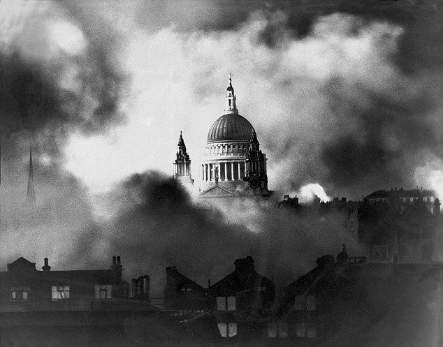 Symbol in the smoke: Herbert Mason's iconic photograph of St Pauls dome emerging from the smoke of raging fires in surrounding streets.