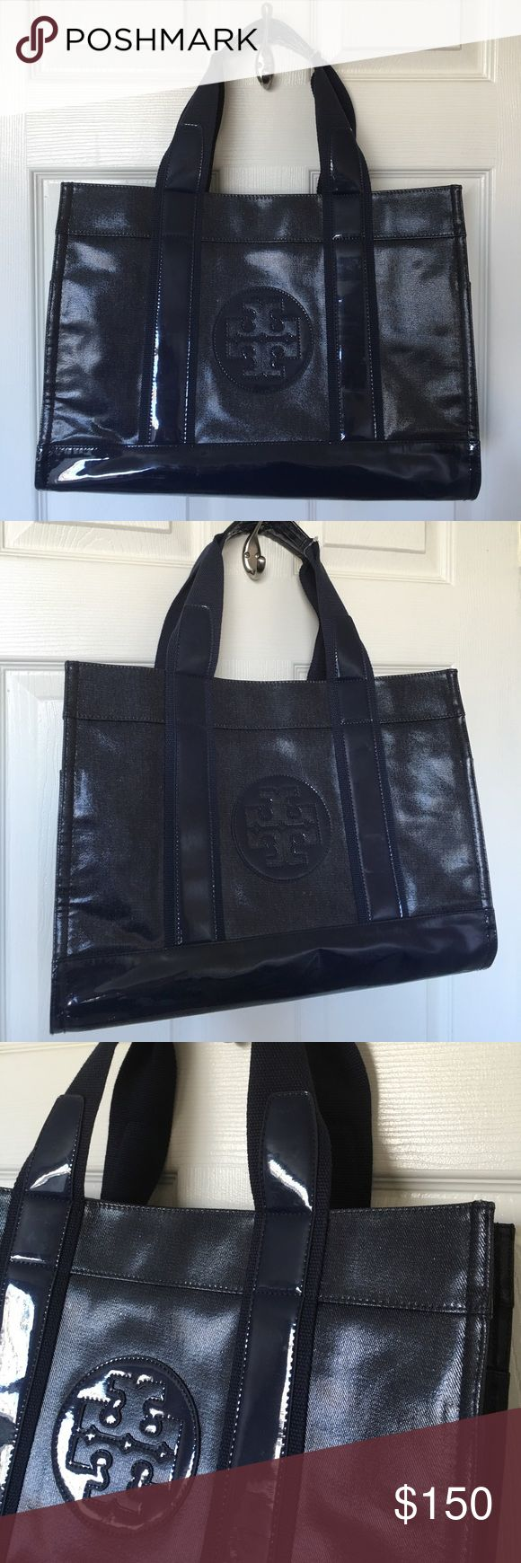"""TORY BURCH Navy Tote Bag Beautiful, Navy, 100% Authentic Tory Burch Patent Tote! Never used! Large bag, Fully lined with beautiful floral print, two inner zip pockets, two outer side pockets, 7 1/2"""" drop double straps. White scuffs on and around the bottom and back of bag from being stored in closet. Some scratches around bag on solid blue patent parts of bag. Approx 15 3/4"""" X 11"""" X 7"""". Tory Burch Bags Totes"""