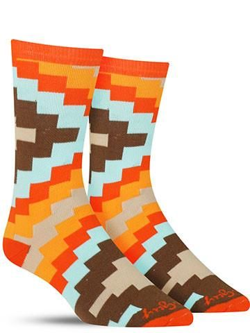With a geometric pattern reminiscent of a Southwestern blanket, these cool men's Aztec socks bring a dash of boldness to your style! Warm red, orange and brown mix with light blue on these stylish soc