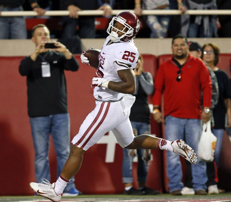 Oklahoma's Joe Mixon (25) scores a touchdown in the first quarter during a college football game between the University of Oklahoma Sooners (OU) and Texas Tech Red Raiders at Jones AT&T Stadium in Lubbock, Texas, Saturday, Oct. 22, 2016. Photo by Nate Billings, The Oklahoman