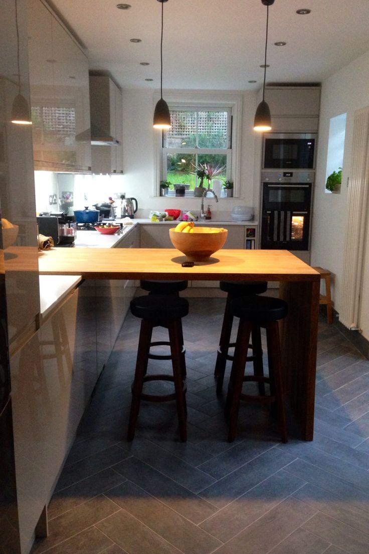 Kitchen refurbishment. Benchmarx gloss cashmere holborn kitchen units and oak breakfast bar kapok wood effect concrete tiles in herringbone