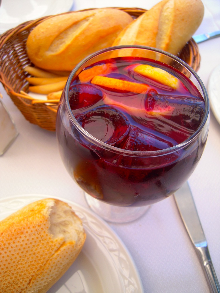 Sangria! I make it using 2 bottles of cheapish red wine, sprite, and a bit of OJ to taste. Let simmer and sit in pitcher with fresh berries, lemons, limes, oranges, pretty much any fruit you love (slightly mushed to get the juices flowing)!!! Feel free to add brandy for more of a kick.