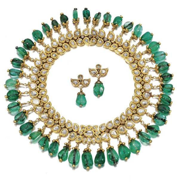 {EMERALD AND DIAMOND NECKLACE, INDIAN, CIRCA 1900.}  Designed as a fringed collar of  foliate design, decorated with rose-cut diamonds in a kundun setting, supporting a graduated fringe of emerald cabochon drops, together with a pair of matching earrings and an alater attachment, French,  length approximately 310 mm, case signed J. Chaumet, Sr de Morel and Cie, London, New Bond Street, 154, Paris, Place Vendôme, 12.
