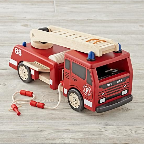 Shop Wooden Fire Engine.  Your kids can go on tons of imaginary rescue adventures with the help of our wooden toy fire truck.  It includes an extendable ladder, fire hose and side panel for extra storage.