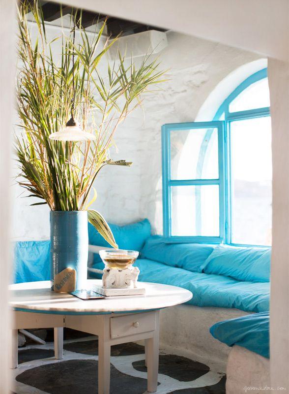 Le Caprice, Mykonos, white walls, blue cushions / Garance Doré