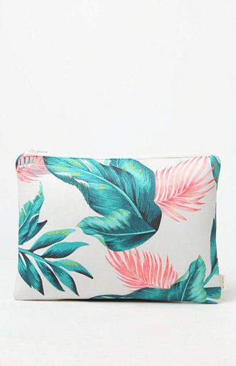 Online Only! Head off to your next weekend or island getaway with the Since Then Neoprene Clutch. Billabong supplies this colorful clutch with its tropical palm leaf print, top zipper closure and soft neoprene construction.   12.5'' x 9'' Tropical palm leaf print Doubles as a toiletry or makeup bag Pop color exposed zipper at top 90% neoprene, 10% nylon