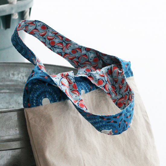 Upgrade a plain canvas tote bag! Make it reversible and add stronger straps. Free strap pattern download included.
