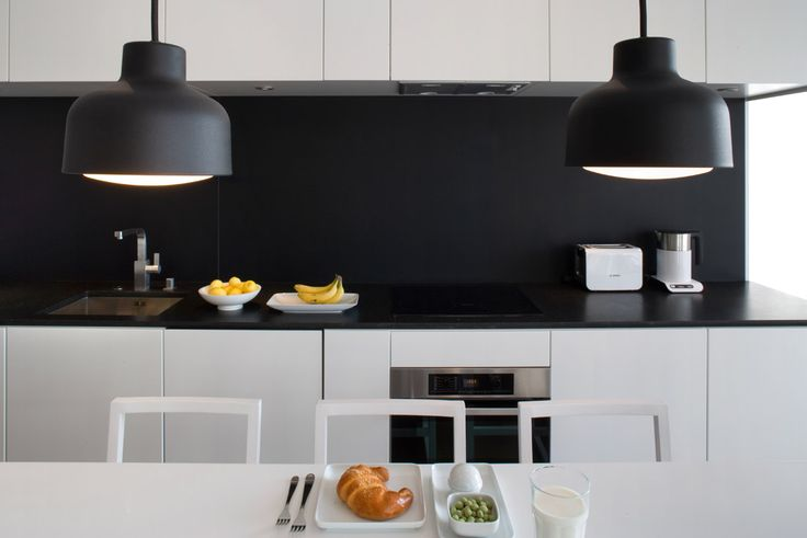 design by idstudio custom made furniture, granite kitchen top  and lamps from swedish zero