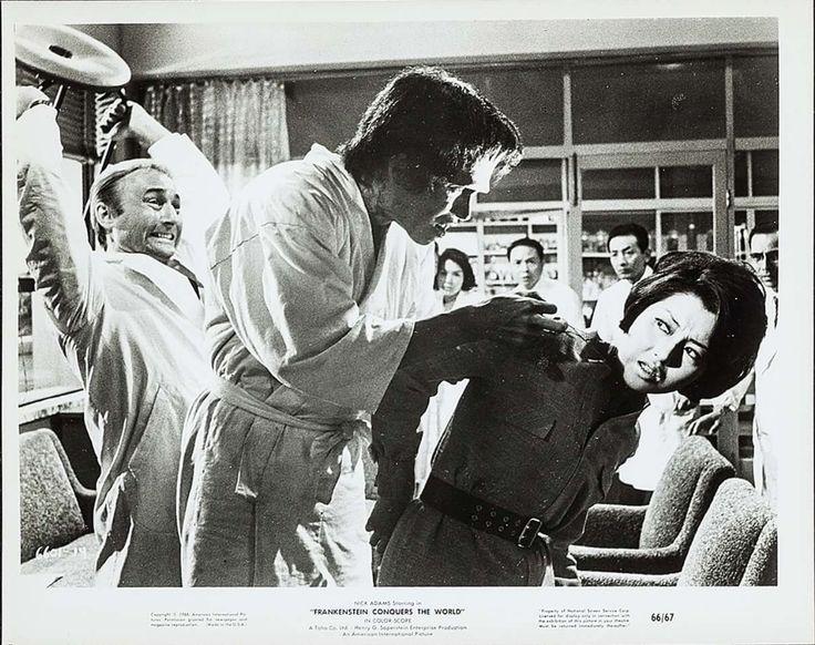 Nick Adams protects Kumi Mizuno from Frankensteins assault.  FRANKENSTEIN CONQUERS THE WORLD (1965)