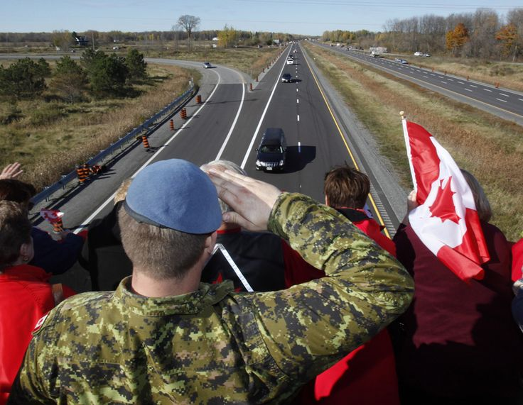 A Canadian Soldier salutes the hearse carrying the body of Cpl. Nathan Cirillo on the Veterans Memorial Highway in Ottawa on Friday, Oct. 24, 2014.  THE CANADIAN PRESS/ Patrick Doyle