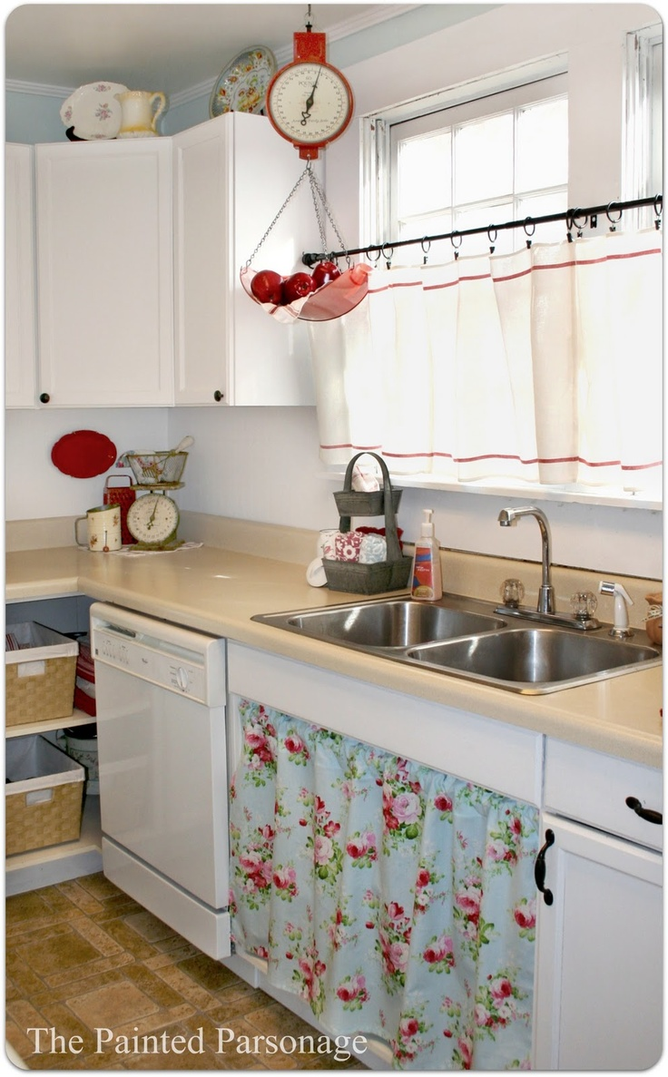 The Painted Parsonage: The Parsonage. Part Four. love the aqua and red, and floral material under sink