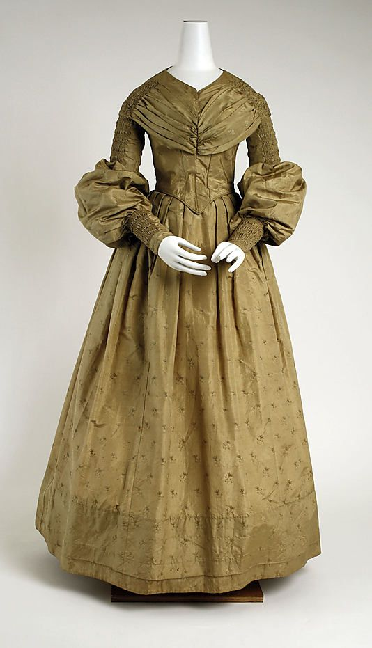 1835 afternoon dress. The mutton sleeves are typical, save one detail. I don't know if I've ever seen them at the elbow and not the shoulder.