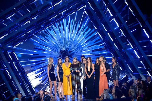 (L-R) Model Martha Hunt, actress Hailee Steinfeld, model Gigi Hadid, actress Serayah, recording artist Taylor Swift, director Joseph Kahn, model Lily Aldridge, actress Mariska Hargitay and model Karlie Kloss accept the Video of the Year award for 'Bad Blood' onstage during the 2015 MTV Video Music Awards at Microsoft Theater on August 30, 2015 in Los Angeles, California.