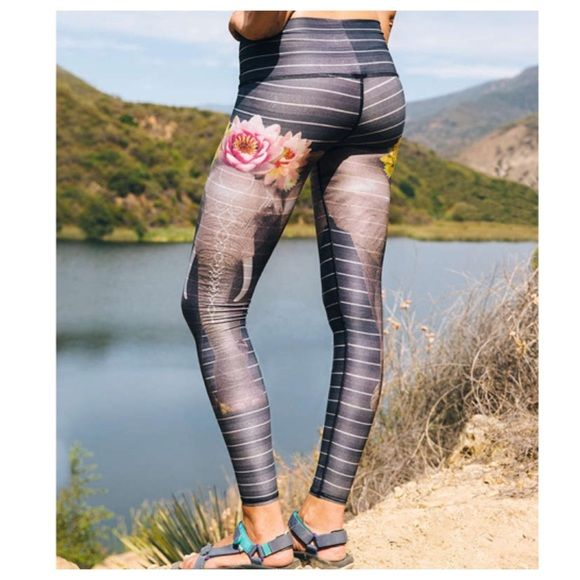 Teeki Love the Elephant Hot Pants Yoga Legging Mystical legging from Teeki made from 79% recycled plastic for an ultra eco-friendly practice. Super soft feel with four-way stretch. Breathable, chafe-resistant, and anti-microbial, with lined gusset. Waistband can be worn high or folded over. Hard to find brand with limited availability. All Teeki clothes are made with love in the USA. Purchased from Urban Outfitters, an Exclusive Retailer. Full price online 11/17/2015.  Content + Care…