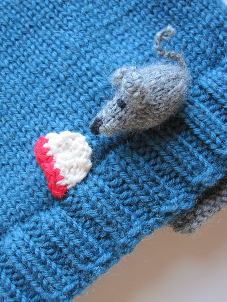 mouse and cheese on the edge of a sweater