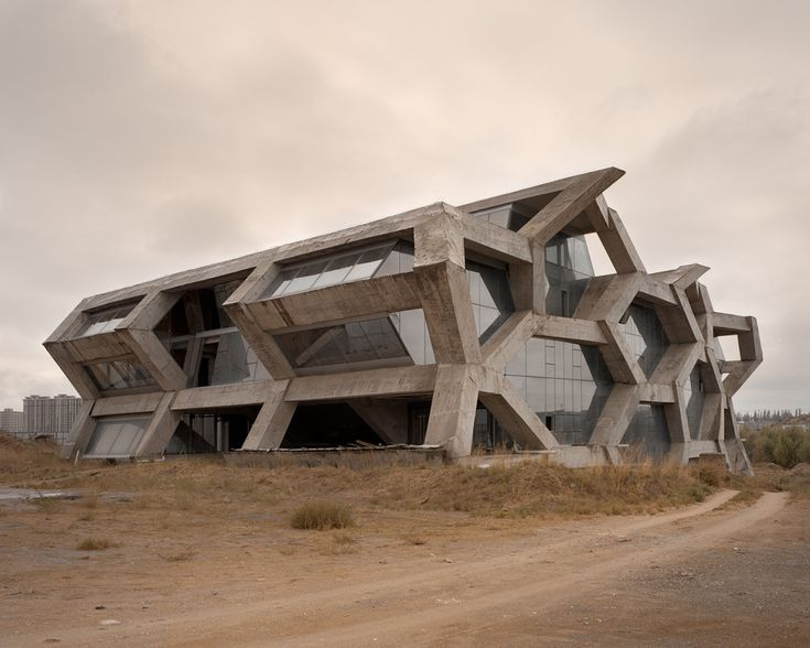 The Unreal, Eerie Emptiness of China's 'Ghost Cities' | Ordos 100 is a construction project curated by Ai Weiwei and architectural firm Herzog & de Meuron near Ordos, Inner-Mongolia.  | Credit: Kai Caemmerer | From Wired.com