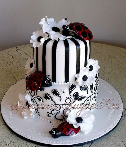 Black and white stripes and flowers cake with ladybugs OHH love this for my teen she has always been my ladybug~