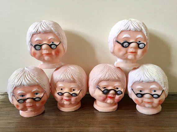 6 plastic granny doll heads
