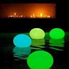Glue sticks in balloons for pool lanterns