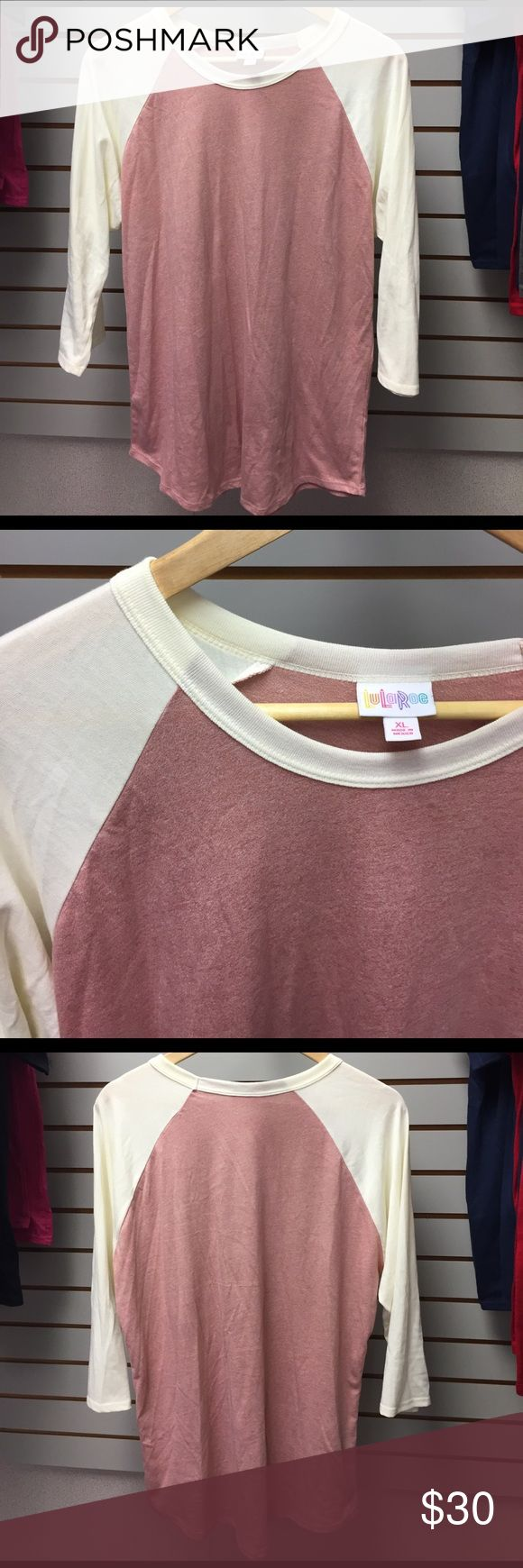 "Lularoe brick red & cream Randy shirt XL Lularoe brick red & cream Randy 3/4 sleeve baseball tee shirt, very gently worn once, no rips holes or stains, women's size XL measures 46"" bust, 42"" waist, approx 29"" total length. 50% cotton 50% polyester. Super soft material with medium stretch. LuLaRoe Tops Tees - Long Sleeve"