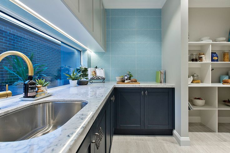 Butlers pantry with gold tapware in the Astor Grange with Classic Hamptons World of Style.
