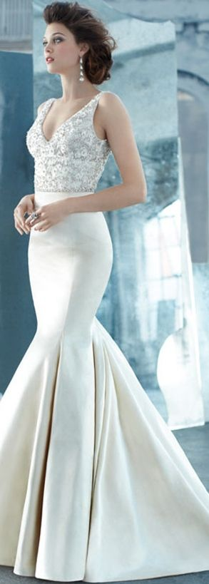 Lazaro.  I like the mermaid shape of this dress and the empire waist.  In another color and shorter length could be a very good latin dress.