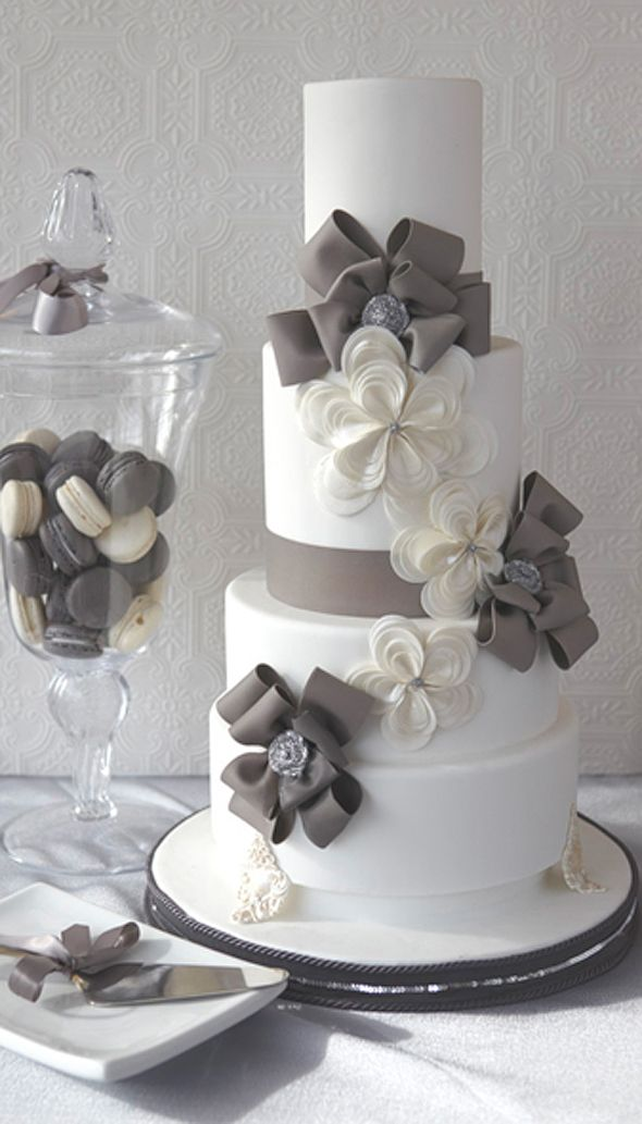 Four-tiered cake with gumpaste ribbon flowers. J'Adore Cakes Co., Toronto, ON, Canada; Photography: Michael Kohn Photography, Toronto, ON, Canada c/o Grace Ormonde Wedding Style.... Not a fan of the flowers but LOVE the bows and grey!