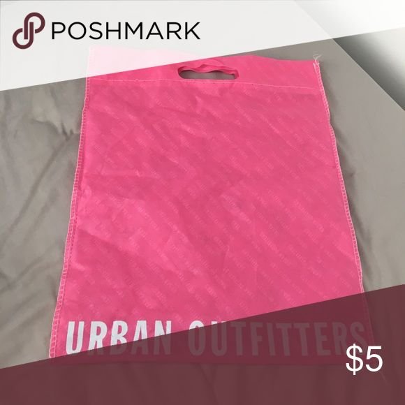 Urban Outfitters Reusable Tote Bag Urban Outfitters Reusable Tote Bag. Medium pink with light blue writing. Reusable hundreds of times. (Have one in black and white as well if you want that one instead or both bundle deals available) Urban Outfitters Bags Totes